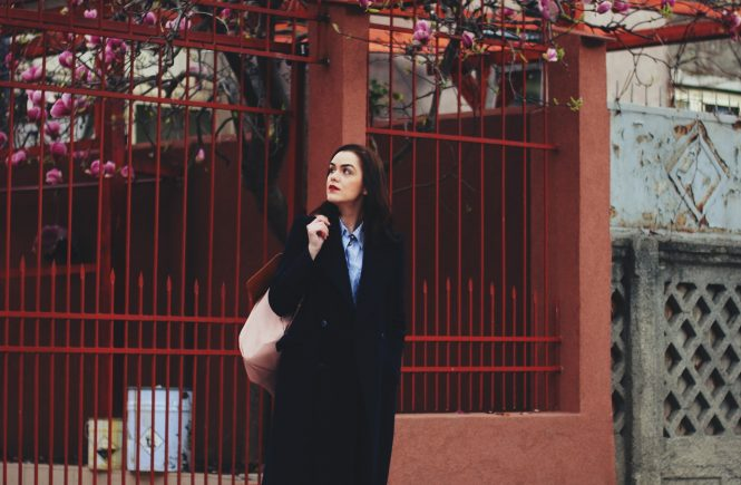 Navy long coat, striped shirt, pink backpack, black distressed jeans, loafers by Andreea Birsan