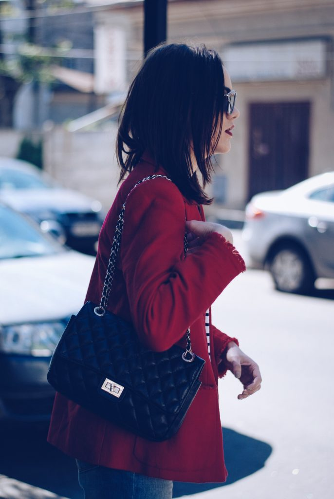 Red blazer, striped shirt, black leather bag, so real sunglasses by Andreea Birsan