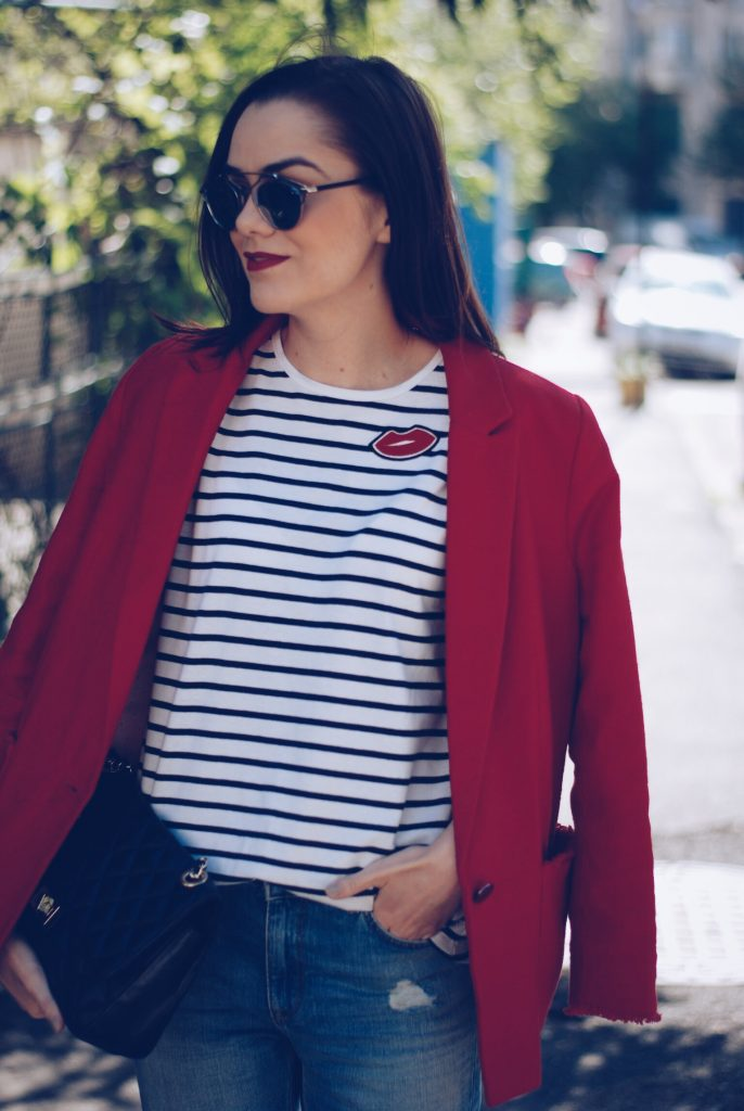 Red blazer, striped shirt, distressed boyfriend jeans, silver shoes, black leather bag, so real sunglasses by Andreea Birsan