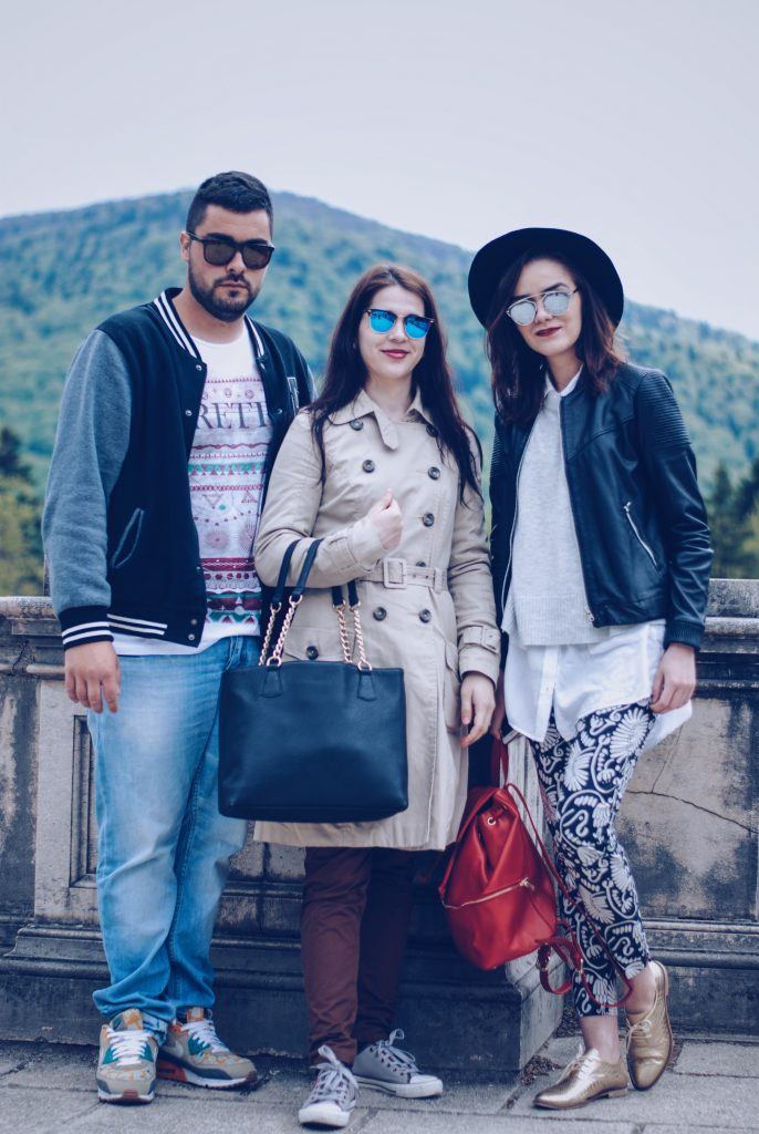 Printed pants, black hat, so real sunglasses, white shirt, grey sweater, leather jacket, gold metallic shoes, red backpack, layers, spring outfit by Andreea Birsan