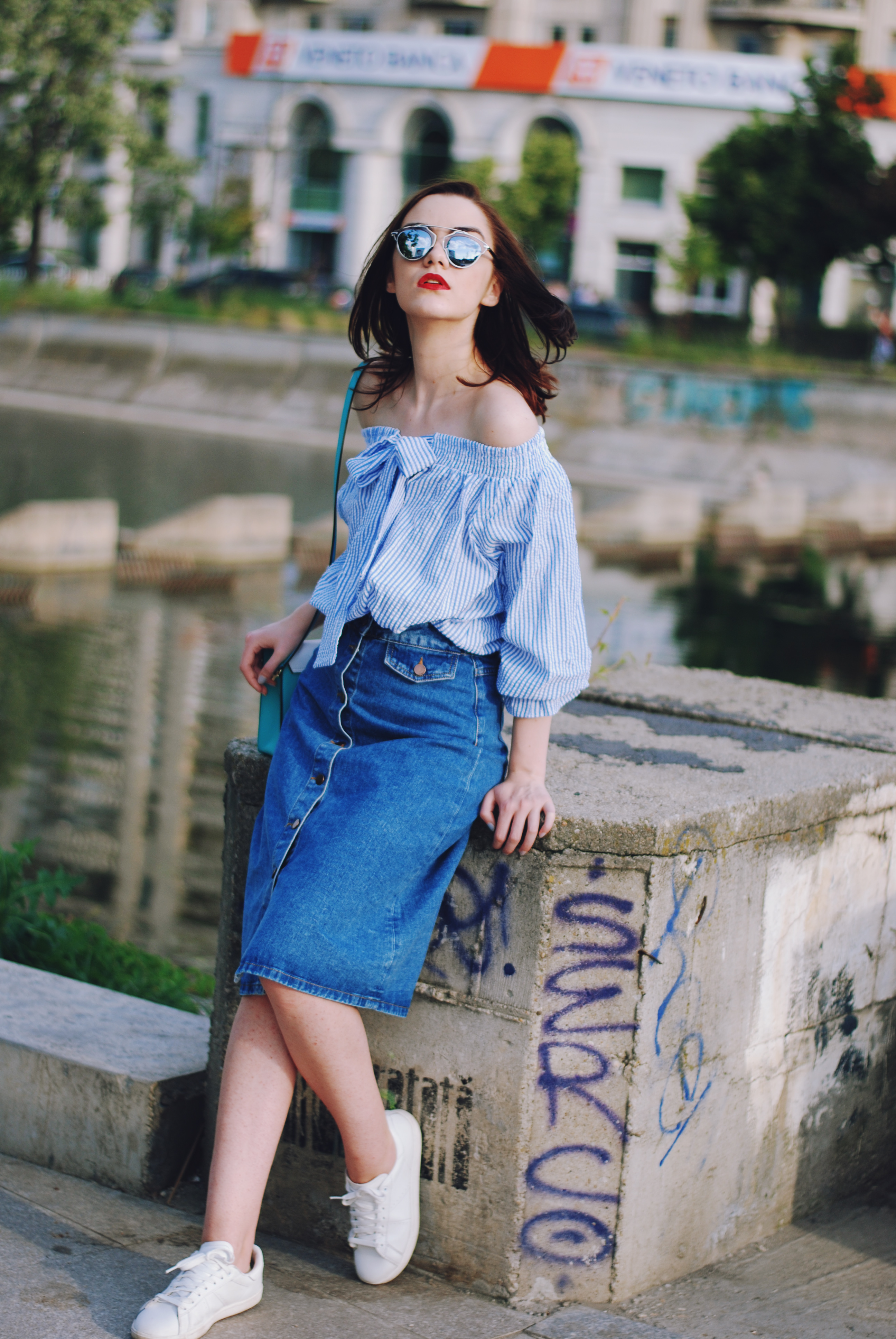 Striped off shoulder top, midi denim button front skirt, color block crossbody bag, white sneakers, so real sunglasses, summer outfit by Andreea Birsan