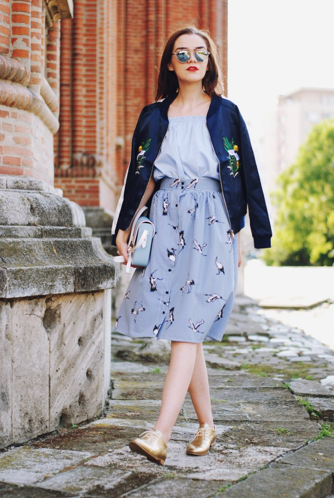 Embroidered bomber jacket, off shoulder top, baby blue crossbody bag, printed midi skirt, gold metallic shoes, sunglasses, fall outfit, Andreea Birsan