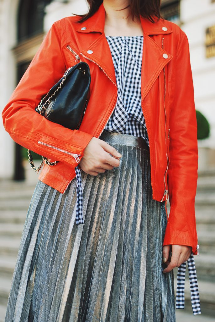 Orange leather jacket, gingham top, silver metallic midi skirt, zara ankle boots, crossbody bag, sunglasses, fall outfit idea, Andreea Birsan