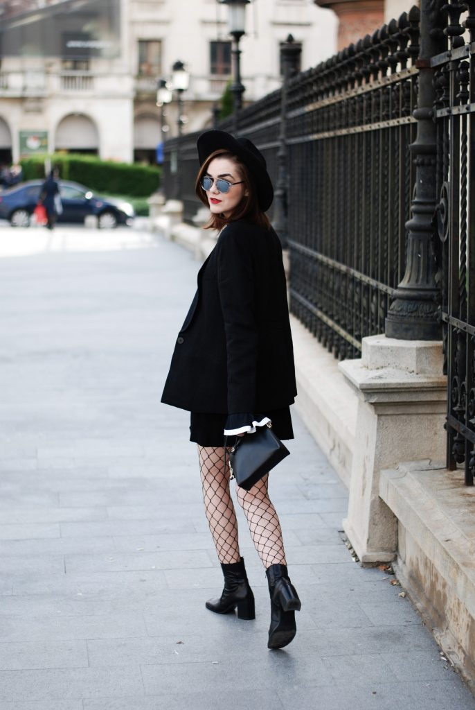 Black blazer, contrast bell sleeve top, mini button front suede skirt, leather ankle boots, Furla crossbody bag, black fedora hat, mirrored sunglasses, fishnet tights, cute casual fall outfit idea, Andreea Birsan, Couturezilla
