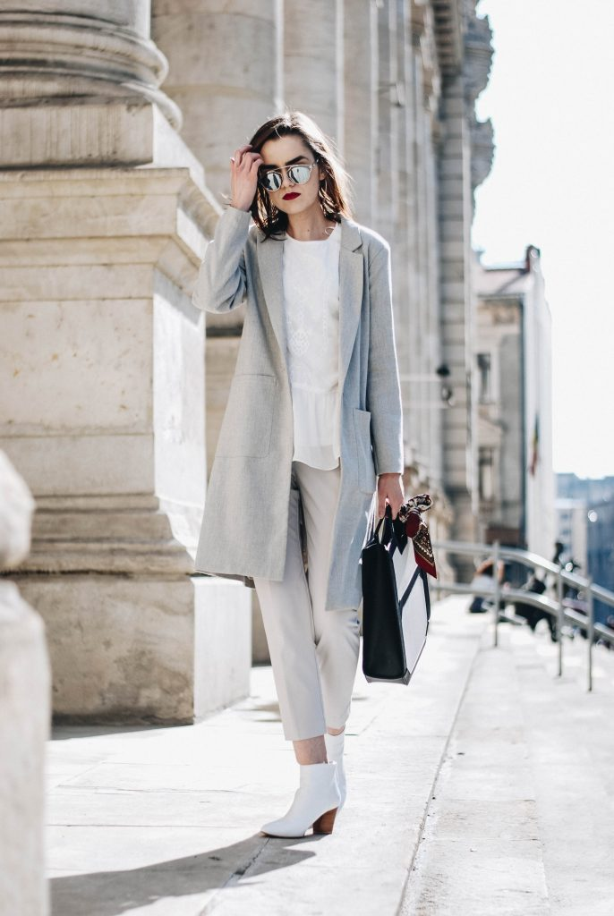 Pull&Bear grey slim fit masculine coat, zara light grey suit pants, trousers, contrast dual tone leather bag, mango white ankle boots, christian dior so real mirrored sunglasses, B&A frilled embroidered shirt, ruffle hem blouse, andreea birsan street style, couturezilla, business spring outfit inspiration 2017, minimal outfit inspo, chic outfit, chic on a budget, how to look chic on a budget, european fashion blogger, how to style a tote bag, how to wear a masculine coat, androgynous, mfw, lfw, pfw, nyfw, fw, fashion week, fashionista, pinterest outfit for women, tumblr girls, european fashion blogger, romanian fashion blog, fashion trends for spring 2017, ootd, outfit of the day, silk scarf, how to look parisian, basic, all grey