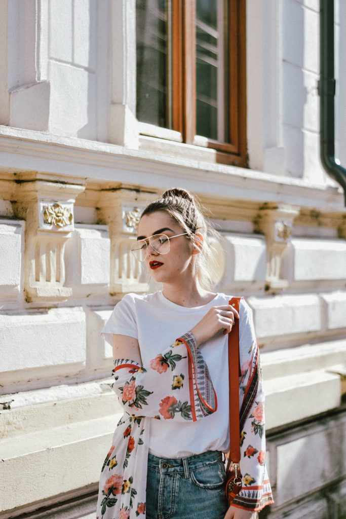 Floral printed kimono, h&m floral kimono how to wear floral prints, florals, fashion summer trends 2017, two tone boyfriend jeans, two tone denim, boyfriend jeans, mom jeans, zara jeans, mango denim, mango t-shirt, asos kimono, urban outfitters, river island, musette summer bag collection, gucci lookalike floral crossbody bag, coral bag, the best bag for summer, the best bag strap trend, gucci green horsebit loafers, emerald green shoes, pumps, high heels, topshop, forever21, green gucci pumps, floral coral bag, ray ban clear lens glasses, how to wear the clear lens glasses you have seen all over instagram, andreea birsan, couturezilla, cute summer outfit inspiration, how to wear your basics in a fresh way, how to stand out in jeans and a tee, how to layer on summer, light layering, summer layers, messy bun, top knot, how to make a top knot, what to wear with a kimono, cafe, how to look parisian chic, reading the newspaper, uk blogger, united kingdom fashion blogger, european fashion blog, romania, paris, summer vibes, girls of tumblr, photos, pictures, fashionista, fashion trends for summer 2017, fashion editorial, andreea birsan street styles, how to look cute in jeans and a t-shirt, summer, what to wear on summer, the perfect summer outfit, summer look, chic outfits for summer, european summer street style for women, girls, pinterest casual outfit idea, outfit inspo, inspiration, outfit of the day, ootd, outfit goals, girl in jeans and tshirt, parisian chic style, street style of summer, what to wear in europe, what to wear when you travel, traveler, lifestyle, cotton tshirt, macarons, raspberries, minimal outfit for women, what to wear on a lazy weekend
