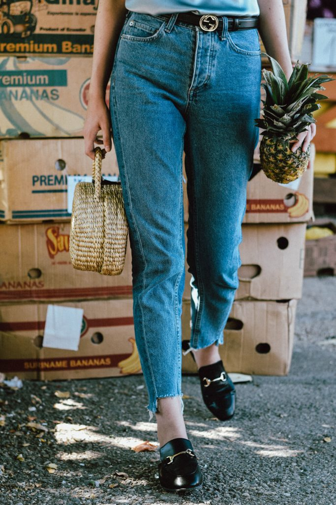 Cloroom silk cami, mulberry silk baby blue camisole top, royal blue, washed blue tank top, sleep wear to street style, how to style sleep wear on the street, the best zara jeans, levi's best fit jeans, h&m two tone step hem mom jeans, tonal denim, two tone denim, best denim trend, the jeans that are all over instagram, the popular mom jeans, gucci double g buckle black leather belt, gucci belt, the trendy gucci belt, gucci dupe mules, classic black fat mules, the high street alternative to the gucci mules, where to find the best gucci lookalike shoes, ego mules, basic black shoes, minimal fashion street style, farmers market, editorial, layered necklaces, straw picnic bag, basket bag, woven bag, raffia bag, straw cute bag, the best summer bag from instagram, where to find the cutest and budget friendly bags, straw boater hat, clear lens aviator glasses on gold frame, andreea birsan, couturezilla, cute summer outfit ideas 2017, how to wear the clear lens glasses trend without looking like a nerd, ways to style a scarf, neck scarf, bird printed scarf, zara scarf, mango jewelry, gold love necklaces, layered necklaces, statement earrings, how to dress minimal and look cool, photos with pineapples, pineapples, editorial at the farmers market with pine apples, cami top, how to style a silk cami top, minimal outfit, minimalist, how to look Parisian chic, European summer street style inspiration for women 2017, pinterest chic outfit ideas for woman, summer outfit ideas, summer ootd inspiration, outfit of the day, ootd, fashion icon, style inspiration, fashionista, fashion inspiration, style inspo, what to wear in summer, how to look French, chic on a budget, zara outfit, mango, topshop, asos, river island, forever 21, urban outfitters, how to mix high end pieces with luxury ones, zara and Gucci, how to look chic when not wearing a dress, outfit alternatives for summer, tomboy chic, minimal outfit, tumblr girls photos, pictures, happy girl, women, smart casual outfits, the best outfit ideas 2017, what to wear when you don't feel inspired, summer in Europe, weekend attire, uniform, French women in summer, European outfit ideas 2017, minimal chic outfit, how to stand out, the best outfit ideas for summer, the sunglasses you have seen everywhere on Instagram, glasses, uk fashion blogger, united kingdom, uk fashion blog, fashion and travel blog, Europe, women with style, street style, summer fashion trends 2017, best fashion ideas, styling