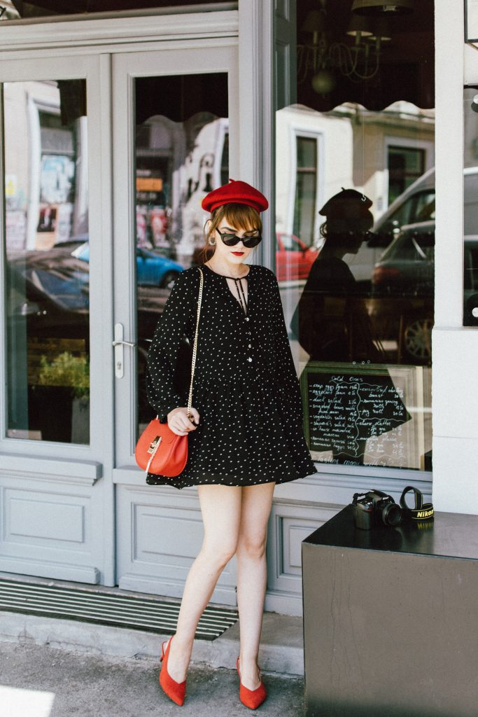 Tea time zara polka dot mini dress, how to appropriately wear a mini dress, tea time dress, polka dotted dress, tea dress, the cute mini dress all girls on instagram are wearing, long sleeve mini dress, red suede slingback shoes, red leather chloe drew shoulder bag, mango retro cat eye sunglasses, red beret, andreea birsan, couturezilla, cute summer outfit ideas 2017, kitten heel red shoes, the popular dress all over instagram and pinterest, how to dress like a french woman, tips on looking parisian chic, how to pull off a beret, what shoes to wear with a mini dress, suede shoes, how to wear slingback shoes without looking like a granny, how to rock kitten heels, red shoes, chloe drew lookalike bag, where to find the best high street alternative to the chloe drew bag, how to wear red like a pro, how to look Parisian chic, European summer street style inspiration for women 2017, pinterest chic outfit ideas for woman, summer outfit ideas, summer ootd inspiration, outfit of the day, ootd, fashion icon, style inspiration, fashionista, fashion inspiration, style inspo, what to wear in summer, how to look French, chic on a budget, zara outfit, mango, topshop, asos, river island, forever 21, urban outfitters, how to mix high end pieces with luxury ones, zara and Gucci, how to look chic when not wearing a dress, outfit alternatives for summer, tomboy chic, minimal outfit, tumblr girls photos, pictures, happy girl, women, smart casual outfits, the best outfit ideas 2017, what to wear when you don't feel inspired, summer in Europe, weekend attire, uniform, French women in summer, European outfit ideas 2017, minimal chic outfit, how to stand out, the best outfit ideas for summer, the sunglasses you have seen everywhere on Instagram, glasses, uk fashion blogger, united kingdom, uk fashion blog, fashion and travel blog, Europe, women with style, street style, summer fashion trends 2017, best fashion ideas, styling