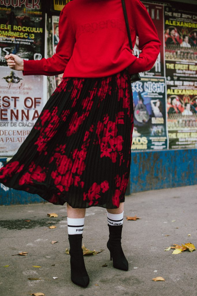 How to layer a red cashmere sweater over a midi floral summer dress, black and red outfit for winter and fall 2017 and 2018, balenciaga lookalike black heeled sock boots, pointy toe sock ankle boots, pleated midi floral dress, dress with flower print, floral print, black baker boy hat, newsboy cap, furla black leather mini shoulder bag, andreea birsan, couturezilla, cute winter outfit ideas 2018, big statement red earrings with pom poms, red earrings, exaggerated earrings trend, how to wear summer dresses in winter like a pro, luxury knitwear, fun 90's socks, how to look Parisian chic, European summer street style inspiration for women 2017, pinterest chic outfit ideas for woman, summer outfit ideas, summer ootd inspiration, outfit of the day, ootd, fashion icon, style inspiration, fashionista, fashion inspiration, style inspo, what to wear in summer, how to look French, chic on a budget, zara outfit, mango, topshop, asos, river island, forever 21, urban outfitters, how to mix high end pieces with luxury ones, zara and Gucci,outfit alternatives for summer, tomboy chic, minimal outfit, tumblr girls photos, pictures, happy girl, women, smart casual outfits, the best outfit ideas 2017, what to wear when you don't feel inspired, summer in Europe, weekend attire, uniform, French women in summer, European outfit ideas 2017, minimal chic outfit, how to stand out, the best outfit ideas for summer, the sunglasses you have seen everywhere on Instagram, glasses, uk fashion blogger, united kingdom, uk fashion blog, fashion and travel blog, Europe, women with style, street style, summer fashion trends 2017, best fashion ideas, styling, fall fashion, fall outfit, fall ootd, fall perfect, transitional dressing, best transitional outfit ideas, how to wear statement earrings, dressing for autumn, autumn outfit, winter outfit ideas for work and school 2017