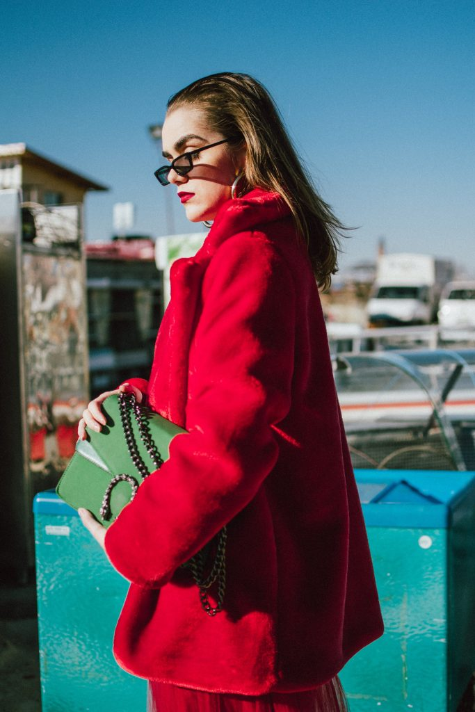 Zara red midi tulle skirt, how to wear a tulle skirt in winter, warm red faux fur coat, heeled black sock boots, balenciaga lookalike boots, balenciaga boots dupe, gucci logo vintage t-shirt, the popular gucci tshirt from instagram, gucci dionysus green suede bag dupe, micro sunglasses, retro sunglasses trend, how to wear the retro sunglasses trend, andreea birsan, couturezilla, cute winter outfit ideas 2018 for 2017, how to wear an all red outfit like a pro, wearing all red in winter 2017 and 2018, cool outfit ideas, editorial 2018, gold hoop earrings, cluse watch, cool girl vibes, what to wear with sock boots, how to look Parisian chic, European summer street style inspiration for women 2017, pinterest chic outfit ideas for woman, summer outfit ideas, summer ootd inspiration, outfit of the day, ootd, fashion icon, style inspiration, fashionista, fashion inspiration, style inspo, what to wear in summer, how to look French, chic on a budget, zara outfit, mango, topshop, asos, river island, forever 21, urban outfitters, how to mix high end pieces with luxury ones, zara and Gucci,outfit alternatives for summer, tomboy chic, minimal outfit, tumblr girls photos, pictures, happy girl, women, smart casual outfits, the best outfit ideas 2017, what to wear when you don't feel inspired, summer in Europe, weekend attire, uniform, French women in summer, European outfit ideas 2017, minimal chic outfit, how to stand out, the best outfit ideas for summer, the sunglasses you have seen everywhere on Instagram, glasses, uk fashion blogger, united kingdom, uk fashion blog, fashion and travel blog, Europe, women with style, street style, summer fashion trends 2017, best fashion ideas, styling, fall fashion, fall outfit, fall ootd, fall perfect, transitional dressing, best transitional outfit ideas, how to wear statement earrings, dressing for autumn, autumn outfit, winter outfit ideas for work and school 2017