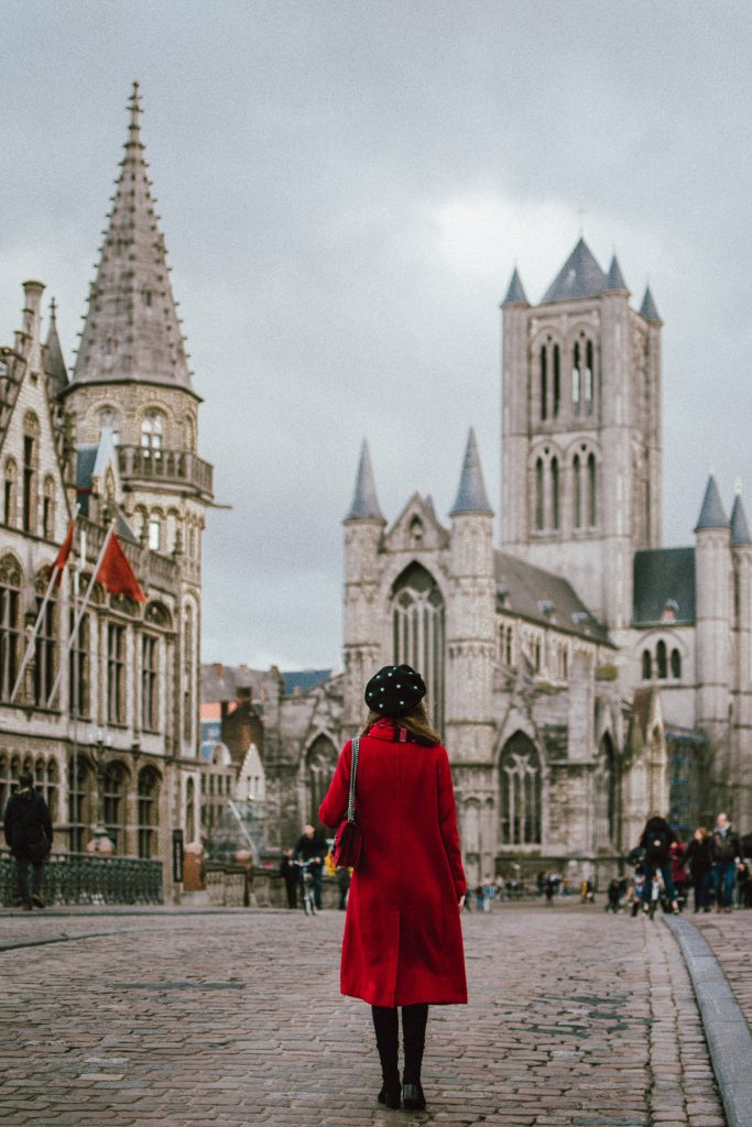 How to spend 24 hours in Ghent, Belgium, travel guide, one day in ghent belgium, andreea birsan, couturezilla, gent, red long coat, pearl embellished black beret, red burberry scarf, cute winter outfit 2018, what to do in ghent, plaid scarf, over the knee boots, otk boots, faux suede over the knee boots, heeled otk boots, black winter boots, how to wear over the knee boots, rhinestone fishnet tights, stockings, how to wear fishnets, real suede mini skirt, button up skirt in black, striped top, stripes and plaid, how to mix prints, where to go in ghent, black cat eye sunglasses, how to wear red like a pro, how to look Parisian chic, European summer street style inspiration for women 2017, pinterest chic outfit ideas for woman, summer outfit ideas, summer ootd inspiration, outfit of the day, ootd, fashion icon, style inspiration, fashionista, fashion inspiration, style inspo, what to wear in summer, how to look French, chic on a budget, zara outfit, mango, topshop, asos, river island, forever 21, urban outfitters, how to mix high end pieces with luxury ones, zara and Gucci,outfit alternatives for summer, tomboy chic, minimal outfit, tumblr girls photos, pictures, happy girl, women, smart casual outfits, the best outfit ideas 2017, what to wear when you don't feel inspired, summer in Europe, weekend attire, uniform, French women in summer, European outfit ideas 2017, minimal chic outfit, how to stand out, the best outfit ideas for summer, the sunglasses you have seen everywhere on Instagram, glasses, uk fashion blogger, united kingdom, uk fashion blog, fashion and travel blog, Europe, women with style, street style, summer fashion trends 2017, best fashion ideas, styling, fall fashion, fall outfit, fall ootd, fall perfect, transitional dressing, best transitional outfit ideas, how to wear statement earrings, dressing for autumn, autumn outfit, winter outfit ideas for work and school 2017