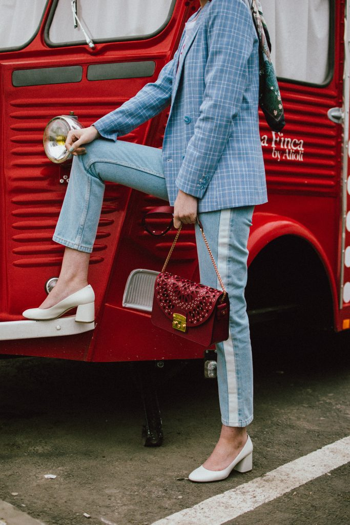 Baby blue checked blazer, statement jeans, furla metropolis red bag, small sunglasses, tee, andreea birsan, couturezilla, cute spring outfit ideas 2018, baby blue blazre, how to wear pastels this spring, jeans with constrastic side panel, redone jeans, reconstructed jeans trend, how to wear reconstructed jeans, red pom pom statement earrings, small cat eye sunglasses in red, retro small sunglasses, small sunnies, matrix sunglasses trend, micro sunglasses trend, red earrings, red and baby blue outfit, how to wear the white shoes trend, white leather high heels, white chuncky heel shoes, white pumps, heart breaker t-shirt, printed tshirt, printed tee, graphic t-shirt, furla red lace cut out metropolis bag, furla leather shoulder bag, furla red metropolis, furla large metropolis bag in red, how to style a furla bag, perfect spring outfit for work and hanging out, red food van, how to look Parisian chic, European summer street style inspiration for women 2017, pinterest chic outfit ideas for woman, summer outfit ideas, summer ootd inspiration, outfit of the day, ootd, fashion icon, style inspiration, fashionista, fashion inspiration, style inspo, what to wear in summer, how to look French, chic on a budget, zara outfit, mango, topshop, asos, river island, forever 21, urban outfitters, how to mix high end pieces with luxury ones, zara and Gucci,outfit alternatives for summer, tomboy chic, minimal outfit, tumblr girls photos, pictures, happy girl, women, smart casual outfits, the best outfit ideas 2017, what to wear when you don't feel inspired, summer in Europe, weekend attire, uniform, French women in summer, European outfit ideas 2017, minimal chic outfit, how to stand out, the best outfit ideas for summer, the sunglasses you have seen everywhere on Instagram, glasses, uk fashion blogger, united kingdom, uk fashion blog, fashion and travel blog, Europe, women with style, street style, summer fashion trends 2017, best fashion ideas, styling, fall fashion, fall outfit, fall ootd, fall perfect, transitional dressing, best transitional outfit ideas, how to wear statement earrings, dressing for autumn, autumn outfit, winter outfit ideas for work and school 2017