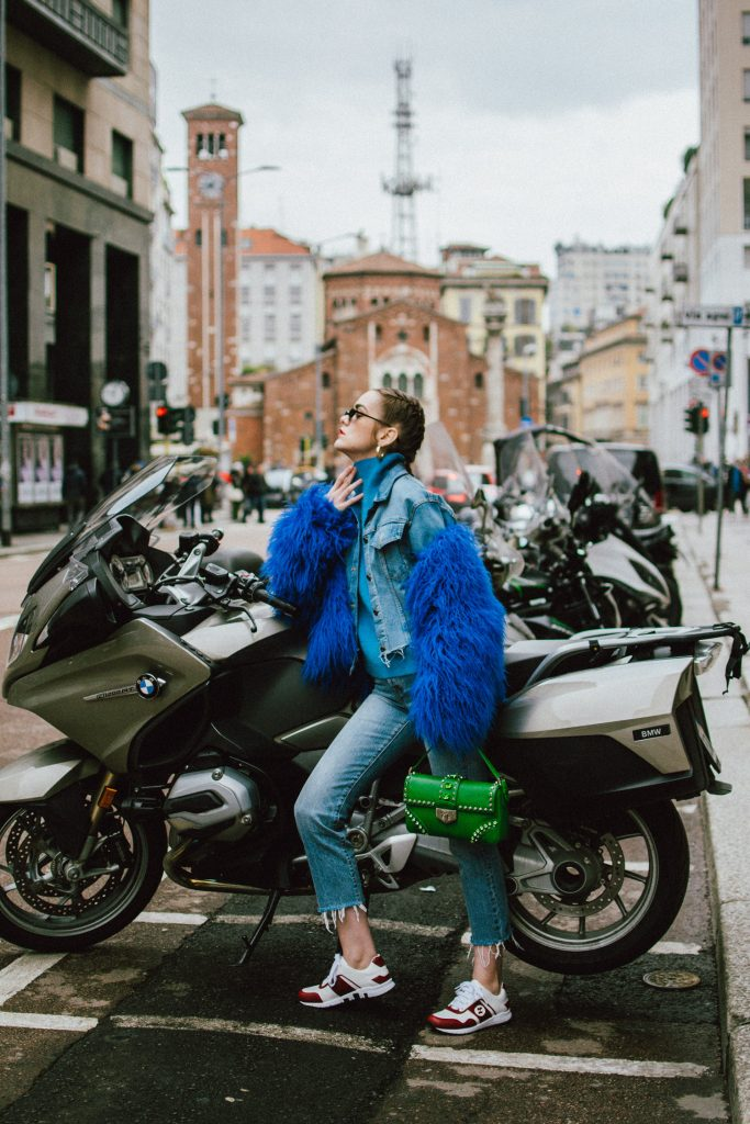 Blue faux fur jacket, levi's cropped light wash jeans, blue cashmere turtleneck sweater, gucci white and red leather sneakers, green saffiano leather prada shoulder bag with studs and stones, small cat eye sunglasses, andreea birsan, couturezilla, cute spring outfit ideas 2018, micro sunglasses trend, retro sunglasses, blue and green outfit, how to pull off double denim, how to wear double denim, denim cropped jacket, denim on denim spring outfit, gold hoop earrings, matrix sunglasses, how to wear the small sunglasses trend, cornbraids hairstyle, green bag, leather shoulder bag, gucci trainers, leather kicks, cookie monster jacket, blue coat, statement jacket, how to look Parisian chic, European summer street style inspiration for women 2017, pinterest chic outfit ideas for woman, summer outfit ideas, summer ootd inspiration, outfit of the day, ootd, fashion icon, style inspiration, fashionista, fashion inspiration, style inspo, what to wear in summer, how to look French, chic on a budget, zara outfit, mango, topshop, asos, river island, forever 21, urban outfitters, how to mix high end pieces with luxury ones, zara and Gucci,outfit alternatives for summer, tomboy chic, minimal outfit, tumblr girls photos, pictures, happy girl, women, smart casual outfits, the best outfit ideas 2017, what to wear when you don't feel inspired, summer in Europe, weekend attire, uniform, French women in summer, European outfit ideas 2017, minimal chic outfit, how to stand out, the best outfit ideas for summer, the sunglasses you have seen everywhere on Instagram, glasses, uk fashion blogger, united kingdom, uk fashion blog, fashion and travel blog, Europe, women with style, street style, summer fashion trends 2017, best fashion ideas, styling, fall fashion, fall outfit, fall ootd, fall perfect, transitional dressing, best transitional outfit ideas, how to wear statement earrings, dressing for autumn, autumn outfit, winter outfit ideas for work and school 2017