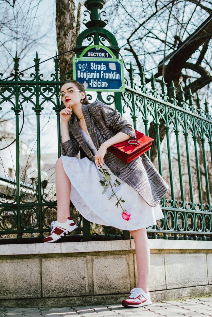Guess white midi dress, oversized checked blazer, check printed oversized blazer, blazer over dress edgy outfit, gucci dionysus red suede shoulder bag, gucci white and red leather sneakers, andreea birsan, couturezilla, cute spring outfit ideas 2018, gucci trainers, white kicks, geeky clear lens glasses trend, the zara aviator glasses, feminine white dress, skater dress, little white dress, how to create an edgy outfit, feminine dress, masculine blazer, boyfriend blazer, pandora gold jewelry, pandora shine, clear lens glasses trend, chic outfit ideas for spring 2018, work appropriate outfit 2018, how to look Parisian chic, European summer street style inspiration for women 2017, pinterest chic outfit ideas for woman, summer outfit ideas, summer ootd inspiration, outfit of the day, ootd, fashion icon, style inspiration, fashionista, fashion inspiration, style inspo, what to wear in summer, how to look French, chic on a budget, zara outfit, mango, topshop, asos, river island, forever 21, urban outfitters, how to mix high end pieces with luxury ones, zara and Gucci,outfit alternatives for summer, tomboy chic, minimal outfit, tumblr girls photos, pictures, happy girl, women, smart casual outfits, the best outfit ideas 2017, what to wear when you don't feel inspired, summer in Europe, weekend attire, uniform, French women in summer, European outfit ideas 2017, minimal chic outfit, how to stand out, the best outfit ideas for summer, the sunglasses you have seen everywhere on Instagram, glasses, uk fashion blogger, united kingdom, uk fashion blog, fashion and travel blog, Europe, women with style, street style, summer fashion trends 2017, best fashion ideas, styling, fall fashion, fall outfit, fall ootd, fall perfect, transitional dressing, best transitional outfit ideas, how to wear statement earrings, dressing for autumn, autumn outfit, winter outfit ideas for work and school 2017, grey blazer