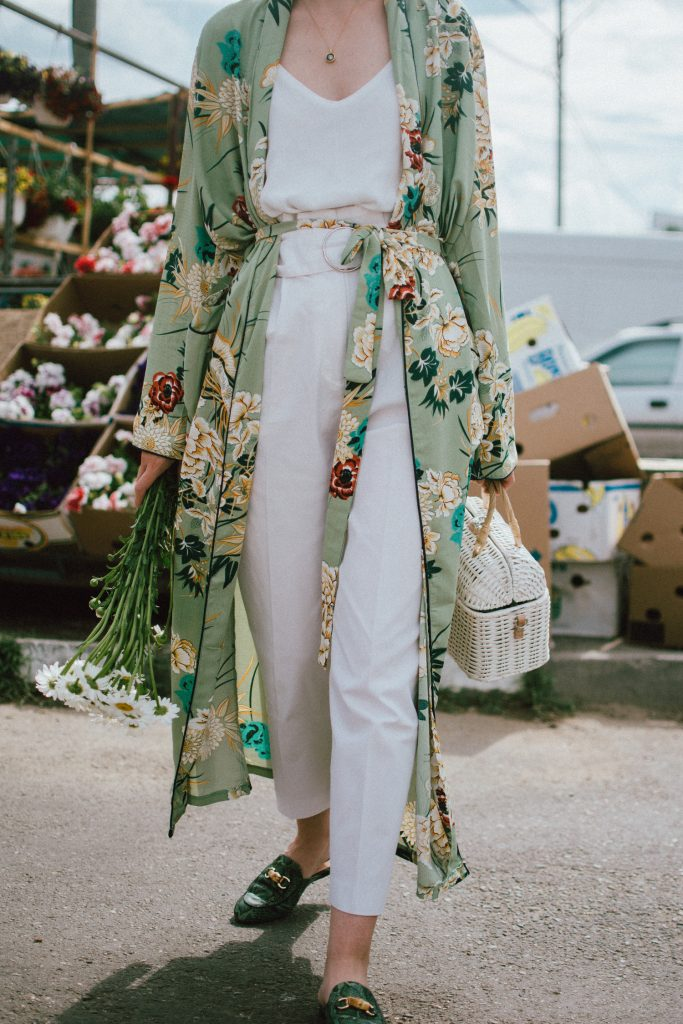 Boohoo green maxi floral kimono, floral print kimono, mango white peg trousers with belt, zara white cami top, musette tropical print leather mules, white handmade basket bag, andreea birsan, couturezilla, cute spring and summer outfit ideas 2018, white straw bag, raffia bag, wicker bag, limited edition mango bag, the cutest bags from mango, bamboo bag, tropical print and floral print, how to mix different prints in one outfit, the not so boring all white outfit for spring and summer, how to wear wide leg trousers, the peg trousers trend, pleated pants, white pants, how to wear white trousers, simple white cami top, wardrobe staples, wardrobe classics, big sunglasses, oversized sunglasses, oversize sunglasses, smoked lens sunglasses, moon necklace, white pants and top, kimono, maxi kimono, how to wear a kimono, the best way to wear a kimono in spring and summer, the popular zara sold out floral print kimono, the zara kimono, how to look Parisian chic, European summer street style inspiration for women 2017, pinterest chic outfit ideas for woman, summer outfit ideas, summer ootd inspiration, outfit of the day, ootd, fashion icon, style inspiration, fashionista, fashion inspiration, style inspo, what to wear in summer, how to look French, chic on a budget, zara outfit, mango, topshop, asos, river island, forever 21, urban outfitters, how to mix high end pieces with luxury ones, zara and Gucci,outfit alternatives for summer, tomboy chic, minimal outfit, tumblr girls photos, pictures, happy girl, women, smart casual outfits, the best outfit ideas 2017, what to wear when you don't feel inspired, summer in Europe, weekend attire, uniform, French women in summer, European outfit ideas 2017, minimal chic outfit, how to stand out, the best outfit ideas for summer, the sunglasses you have seen everywhere on Instagram, glasses, uk fashion blogger, united kingdom, uk fashion blog, fashion and travel blog, Europe, women with style, street style, summer fashion trends 2017, best fashion ideas, styling, fall fashion, fall outfit, fall ootd, fall perfect, transitional dressing, best transitional outfit ideas, how to wear statement earrings, dressing for autumn, autumn outfit, winter outfit ideas for work and school 2017