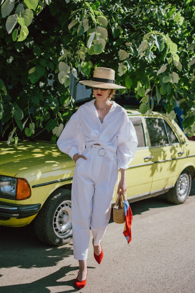 Mango white trousers, high waisted peg trousers, high waist pants, white pants, white trousers, cotton trousers, the peg trousers trend, paperbag waist trousers, white button down shirt, balloon sleeve shirt, deconstructed white shirt, how to wear your classic white shirt in summer, white button down, white shirt, boater straw hat, fedora straw hat, straw bag, raffia bag, basket bag, woven bag, the best bag for summer and spring, the cutest mini bag, handmade bag, sea and grass bag, red slingbacks, red slingback shoes with kitten heel, red shoes, all white outfit for spring and summer, andreea birsan, couturezilla, cute spring outfit ideas 2018, how to wear all white, white ootd, statement jewellry, white shirt in spring, pearl earrings, layered gold necklaces, micro cat eye sunglasses, mini sunglasses, micro sunglasses trend, retro sunglasses trend, 90s sunglasses, matrix sunglasses, micro sunnies, cat eye sunglasses in black, striped silk scarf, stripes, mini scarf, neck scarf, retro look, vintage inspired outfit, vintage ootd, tie waist shirt, upgrade your white shirt, tie white shirt, how to look Parisian chic, European summer street style inspiration for women 2017, pinterest chic outfit ideas for woman, summer outfit ideas, summer ootd inspiration, outfit of the day, ootd, fashion icon, style inspiration, fashionista, fashion inspiration, style inspo, what to wear in summer, how to look French, chic on a budget, zara outfit, mango, topshop, asos, river island, forever 21, urban outfitters, how to mix high end pieces with luxury ones, zara and Gucci,outfit alternatives for summer, tomboy chic, minimal outfit, tumblr girls photos, pictures, happy girl, women, smart casual outfits, the best outfit ideas 2017, what to wear when you don't feel inspired, summer in Europe, weekend attire, uniform, French women in summer, European outfit ideas 2017, minimal chic outfit, how to stand out, the best outfit ideas for summer, the sunglasses you have seen everywhere on Instagram, glasses, uk fashion blogger, united kingdom, uk fashion blog, fashion and travel blog, Europe, women with style, street style, summer fashion trends 2017, best fashion ideas, styling, fall fashion, fall outfit, fall ootd, fall perfect, transitional dressing, best transitional outfit ideas, how to wear statement earrings, dressing for autumn, autumn outfit, winter outfit ideas for work and school 2017
