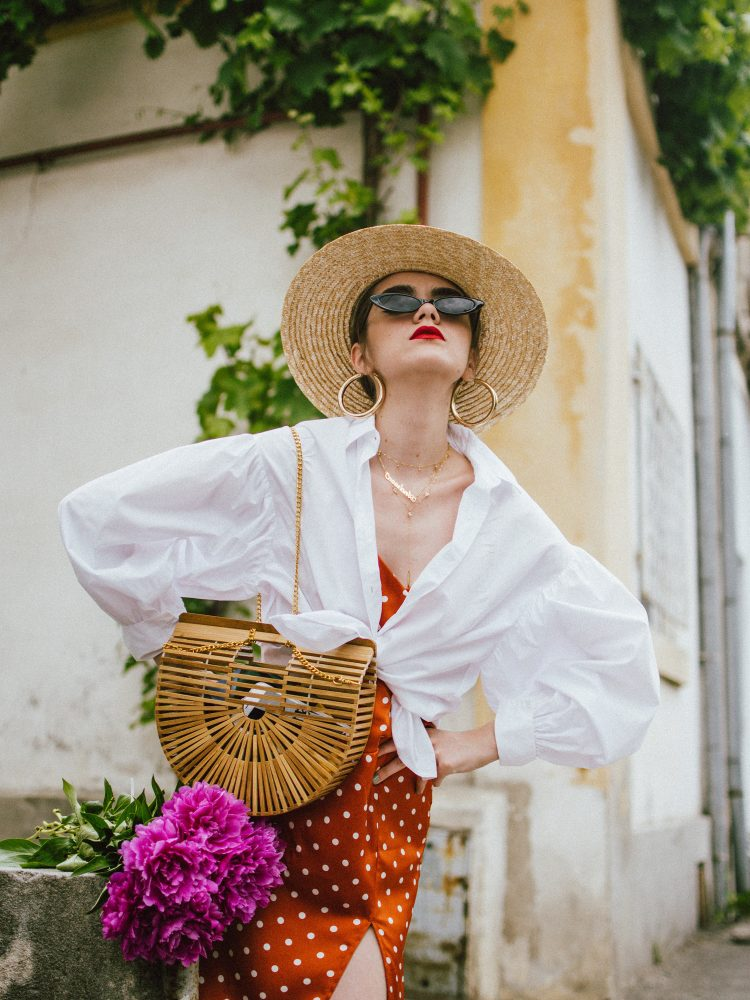Orange boohoo midi polka dot midi dress, mango white balloon sleeve shirt shirt, h&m natural straw hat, cult gaia ark bag, tommy hilfiger white sneakers, andreea birsan, couturezilla, cute summer outfit ideas 2018. white trainers and dress, midi dress and sneakers, what to wear with a polka dot dress, midi polka dot dress with slit, orange dress, how to wear orange, what to wear with orange, rust color dress, what colors to wear this summer, how to wear sneakers and dresses, mixing feminine with masculine elements, athleisure, sexy polka dot dress, boater hat, cult gaia ark inspired bag, petite sardine bag, portuguese bag, bamboo bag, how to wear a white shirt, button up shirt, cotton shirt, how to layer in summer, layered summer dress, summer layers, white sneakers, white trainers, tommy hilfiger, gold accessories, small cat eye sunglasses, 90s inspired sunglasses, micro sunglasses trend, mini sunglasses, cat eye sunnies, the sold out asos sunglasses, chic bags to wear in spring and summer, raffia bag, straw bag, handmade bag, peonies, how to look Parisian chic, European summer street style inspiration for women 2017, pinterest chic outfit ideas for woman, summer outfit ideas, summer ootd inspiration, outfit of the day, ootd, fashion icon, style inspiration, fashionista, fashion inspiration, style inspo, what to wear in summer, how to look French, chic on a budget, zara outfit, mango, topshop, asos, river island, forever 21, urban outfitters, how to mix high end pieces with luxury ones, zara and Gucci,outfit alternatives for summer, tomboy chic, minimal outfit, tumblr girls photos, pictures, happy girl, women, smart casual outfits, the best outfit ideas 2017, what to wear when you don't feel inspired, summer in Europe, weekend attire, uniform, French women in summer, European outfit ideas 2017, minimal chic outfit, how to stand out, the best outfit ideas for summer, the sunglasses you have seen everywhere on Instagram, glasses, uk fashion blogger, united kingdom, uk fashion blog, fashion and travel blog, Europe, women with style, street style, summer fashion trends 2017, best fashion ideas, styling, fall fashion, fall outfit, fall ootd, fall perfect, transitional dressing, best transitional outfit ideas, how to wear statement earrings, dressing for autumn, autumn outfit, winter outfit ideas for work and school 2017