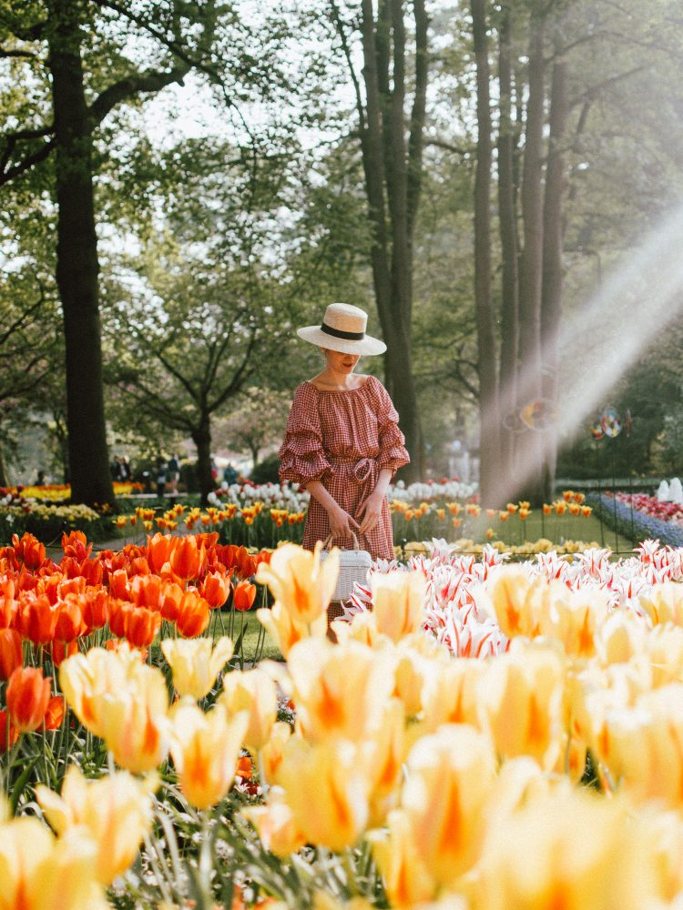Keukenhof, red gingham dress, midi dress, gucci sneakers, straw bag, andreea birsan, couturezilla, cute summer outfit ideas 2018, when to visit the tulip fields in the netherlands, the best time to visit the dutch tulip fields, the keukenhof gardens, plan a trip to the netherlands, holland, dutch tulips, dutch tulip garden near amsterdam, the most beautiful park in europe, where to find the most beautiful flowers for photos, instagram worthy spots in holland, the popular tulip fields from instagram, the best time for visiting the popular tulip fields you keep seeing on instagram, zara sold out midi gingham dress, h&m straw boater hat, flower fields, white dress, straw bag, the white wicker bag from mango, mango white straw box bag, box bag, handmade bamboo bag, the best summer bags, handmade bags, soap bubbles, keukenhof park, keukenhof gardens, the price for a ticket at keukenhof, how's the weather at keukenhof, lisse, the netherlands, hollidays in the netherlands, gucci ace heart embroidered sneakers, white leather trainers, white gucci shoes, gucci white shoes with hearts, gucci ace sneakers, the best gucci sneakers, how to look Parisian chic, European summer street style inspiration for women 2017, pinterest chic outfit ideas for woman, summer outfit ideas, summer ootd inspiration, outfit of the day, ootd, fashion icon, style inspiration, fashionista, fashion inspiration, style inspo, what to wear in summer, how to look French, chic on a budget, zara outfit, mango, topshop, asos, river island, forever 21, urban outfitters, how to mix high end pieces with luxury ones, zara and Gucci,outfit alternatives for summer, tomboy chic, minimal outfit, tumblr girls photos, pictures, happy girl, women, smart casual outfits, the best outfit ideas 2017, what to wear when you don't feel inspired, summer in Europe, weekend attire, uniform, French women in summer, European outfit ideas 2017, minimal chic outfit, how to stand out, the best outfit ideas for summer, the sunglasses you have seen everywhere on Instagram, glasses, uk fashion blogger, united kingdom, uk fashion blog, fashion and travel blog, Europe, women with style, street style, summer fashion trends 2017, best fashion ideas, styling, fall fashion, fall outfit, fall ootd, fall perfect, transitional dressing, best transitional outfit ideas, how to wear statement earrings, dressing for autumn, autumn outfit, winter outfit ideas for work and school 2017