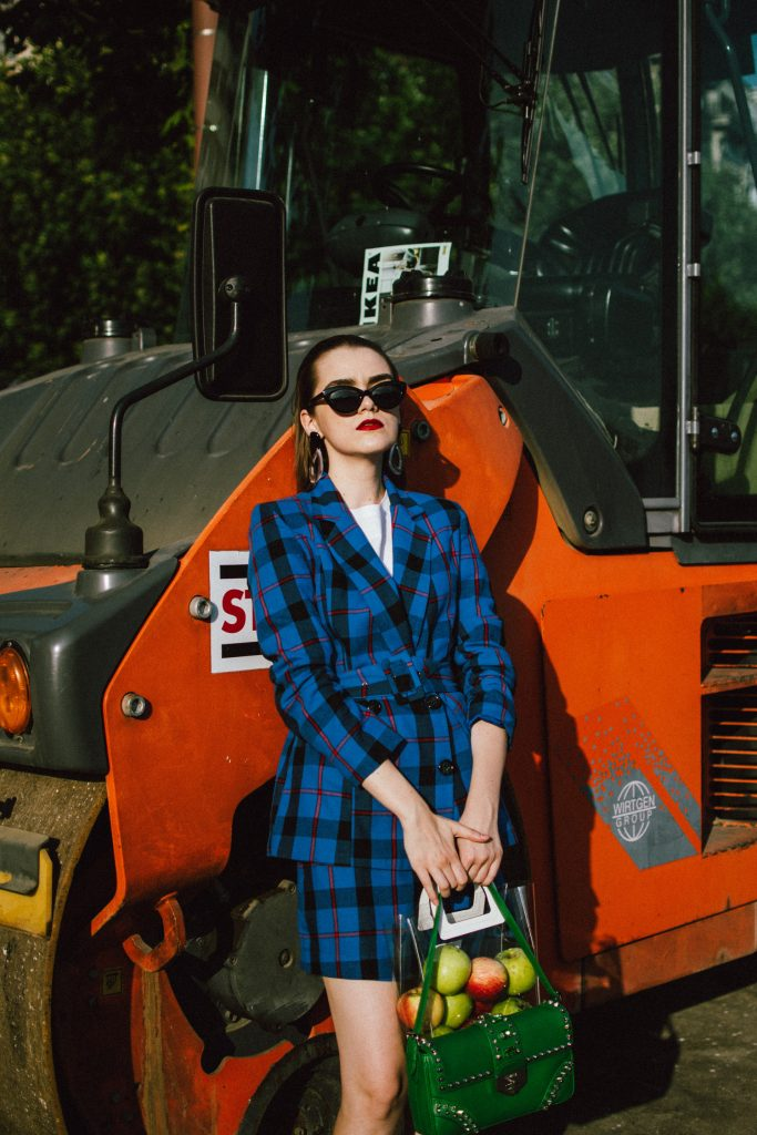Blue check printed suit, white heels, prada green bag, viny bag, cat eye sunglasses, andreea birsan, couturezilla, cute fall outfit ideas 2018, boohoo blue belted blazer, double breasted blue blazer, woven check print co-ord set, fall outfit ideas 2018, checked suit for women, blue check printed two piece suit set for women, blue check printed mini skirt with buttons, blue mini wrap skirt, blue set for women, blue suit for women, skirt and blazer outfit ideas for fall, white leather pumps, white leather block heel shoes, musette shoes, genuine leather shoes, green prada saffiano leather shoulder bag with studs and stones, statement prada bag, green and blue outfit, green leather prada bag, statement prada bag, shoulder bag, prada bags, saffiano leather, unscratchable leather, black cat eye sunglasses, cat eye sunnies, cat eye glasses, retro outfit, vinyl tote bag, staud inspired vinyl bag, see through bag trend, mango see through bag, mango mini vinyl tote bag, the vinyl bag trend, how to wear a clear bag, clear bag trend, acrylic earrings, statement earrings, where to find the best earrings, clear earrings, accessories, mango white t-shirt, best belted blazers, boohoo business suit, business inspired outfit, smart business look, how to dress for a corporate job, business outfit, blue and green outfit for fall, autumn outfit 2018, checkered suit, check printed suit,  how to look Parisian chic, European summer street style inspiration for women 2017, pinterest chic outfit ideas for woman, summer outfit ideas, summer ootd inspiration, outfit of the day, ootd, fashion icon, style inspiration, fashionista, fashion inspiration, style inspo, what to wear in summer, how to look French, chic on a budget, zara outfit, mango, topshop, asos, river island, forever 21, urban outfitters, how to mix high end pieces with luxury ones, zara and Gucci,outfit alternatives for summer, tomboy chic, minimal outfit, tumblr girls photos, pictures, happy girl, women, smart casual outfits, the best outfit ideas 2017, what to wear when you don't feel inspired, summer in Europe, weekend attire, uniform, French women in summer, European outfit ideas 2017, minimal chic outfit, how to stand out, the best outfit ideas for summer, the sunglasses you have seen everywhere on Instagram, glasses, uk fashion blogger, united kingdom, uk fashion blog, fashion and travel blog, Europe, women with style, street style, summer fashion trends 2017, best fashion ideas, styling, fall fashion, fall outfit, fall ootd, fall perfect, transitional dressing, best transitional outfit ideas, how to wear statement earrings, dressing for autumn, autumn outfit, winter outfit ideas for work and school 2017