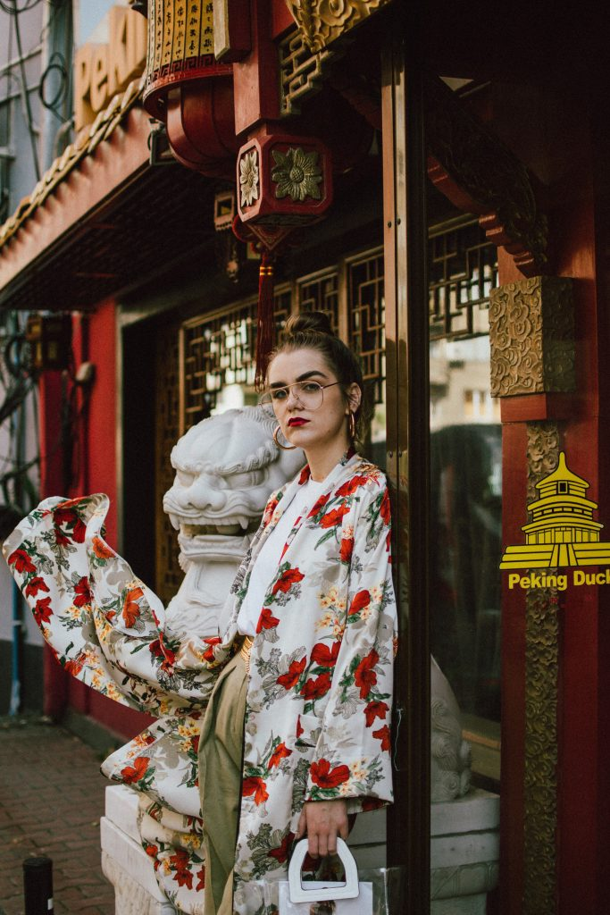 Boohoo longline floral kimono, khaki peg trousers, white t-shirt, transparent bag, yellow slingback shoes, andreea birsan, couturezilla, cute fall outfit ideas 2018, beige satin floral kimono, what to wear with a kimono, how to wear a floral kimono in autumn, autumn outfit, how to transition from summer to autumn, mango oversized boyfriend white t-shirt, white tee, khaki trousers, khaki wide leg trousers, how to wear peg trousers without looking bulky, china town editorial, yellow suede kitten heel slingback shoes, yellow slingbacks, yellow high heel shoes, how to wear yellow shoes, what color goes with yellow, yellow khaki and white outfit, the pvc bag trend, how to pull off the transparent bag trend, clear tote bag, staud inspired clear bag, the plastic bag trend, clear lens aviator glasses, how to pull off the geeky glasses trend, clear lens glasses, gold hoop earrings, gold metallic vintage belt, how to wear a gold belt, floral kimono, long kimono, baggy trousers trend, khaki pants, khaki pants, wide pants, lemons, how to look Parisian chic, European summer street style inspiration for women 2017, pinterest chic outfit ideas for woman, summer outfit ideas, summer ootd inspiration, outfit of the day, ootd, fashion icon, style inspiration, fashionista, fashion inspiration, style inspo, what to wear in summer, how to look French, chic on a budget, zara outfit, mango, topshop, asos, river island, forever 21, urban outfitters, how to mix high end pieces with luxury ones, zara and Gucci,outfit alternatives for summer, tomboy chic, minimal outfit, tumblr girls photos, pictures, happy girl, women, smart casual outfits, the best outfit ideas 2017, what to wear when you don't feel inspired, summer in Europe, weekend attire, uniform, French women in summer, European outfit ideas 2017, minimal chic outfit, how to stand out, the best outfit ideas for summer, the sunglasses you have seen everywhere on Instagram, glasses, uk fashion blogger, united kingdom, uk fashion blog, fa