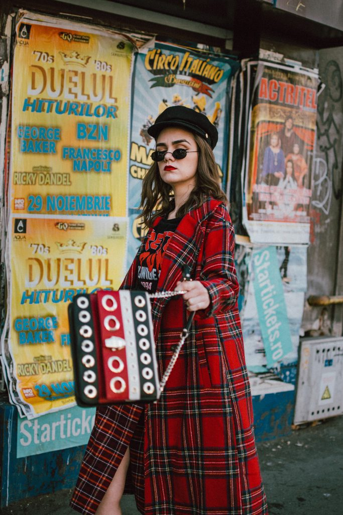 Red tartan coat, midi wrap tartan skirt, black graphic t-shirt, baker boy hat, statement bag, sock boots, andreea birsan street style, couturezilla, cute fall outfit ideas 2018. Boohoo long line red tartan coat, how to wear tartan like a pro, how to wear double tartan, mixing prints in fall 2018, tartan outfit 2018, how to wear red, the baker boy hat trend, newsboy hat, baker boy cap, black military inspired hat, black cap, soft curls, micro oval sunglasses, black vintage sunglasses, small oval sunglasses, punk black graphic t-shirt, red on red outfit, black heeled sock boots, balenciaga inspired sock boots, mango sock boots, where to find the budget alternative of the balenciaga knife sock boots, balenciaga sock boots dupes, cavalli class striped black red and white bag with big eyelets, cavalli class stripe leather shoulder bag, statement shoulder bag, red black and white shoulder bag, multicolor shoulder bag, colorblock leather bag, midi wrap tartan skirt, what shoes go with a midi skirt, midi skirt and heeled sock boots, wrap burgundy tartan midi dress, check print midi dress, scotish print, how to wear tartan in fall and winter 2018, tartan outfit street style 2018, how to look Parisian chic, European summer street style inspiration for women 2017, pinterest chic outfit ideas for woman, summer outfit ideas, summer ootd inspiration, outfit of the day, ootd, fashion icon, style inspiration, fashionista, fashion inspiration, style inspo, what to wear in summer, how to look French, chic on a budget, zara outfit, mango, topshop, asos, river island, forever 21, urban outfitters, how to mix high end pieces with luxury ones, zara and Gucci,outfit alternatives for summer, tomboy chic, minimal outfit, tumblr girls photos, pictures, happy girl, women, smart casual outfits, the best outfit ideas 2017, what to wear when you don't feel inspired, summer in Europe, weekend attire, uniform, French women in summer, European outfit ideas 2017, minimal chic outfit, how to stand out, the best outfit ideas for summer, the sunglasses you have seen everywhere on Instagram, glasses, uk fashion blogger, united kingdom, uk fashion blog, fashion and travel blog, Europe, women with style, street style, summer fashion trends 2017, best fashion ideas, styling, fall fashion, fall outfit, fall ootd, fall perfect, transitional dressing, best transitional outfit ideas, how to wear statement earrings, dressing for autumn, autumn outfit, winter outfit ideas for work and school