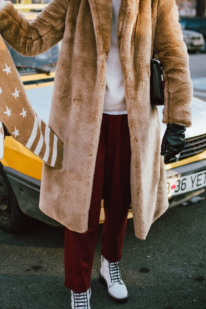 Beige faux fur coat, copper trousers, cashmere turtleneck sweater, white leather boots, andreea birsan streetstyle, couturezilla, cute winter outfit ideas 2018, where to find the best faux fur coat on the market, italian faux fur coat, luxe looking coat, midi length faux fur coat, how to style a faux fur coat, neutral tones outfit, copper straight leg trousers, how to wear white leather boots, white boots, combat white boots, military white boots for women, black baker boy hat, cavalli class statement bag with stripes and eyelets, beige cashmere turtleneck sweater, how to wear cashmere sweaters, where to find the best cashmere sweater, shades of beige winter outfit, beige winter outfit ideas, genuine leather chanel gloves, statement bag in red white and black, how to stay warm in winter, cozy and warm winter coats, fashionable and warm winter coats, how to wear beige, what other colors to wear with beige, avoid wearing black in winter, a non black winter outfit, how to look Parisian chic, European summer street style inspiration for women 2017, pinterest chic outfit ideas for woman, summer outfit ideas, summer ootd inspiration, outfit of the day, ootd, fashion icon, style inspiration, fashionista, fashion inspiration, style inspo, what to wear in summer, how to look French, chic on a budget, zara outfit, mango, topshop, asos, river island, forever 21, urban outfitters, how to mix high end pieces with luxury ones, zara and Gucci,outfit alternatives for summer, tomboy chic, minimal outfit, tumblr girls photos, pictures, happy girl, women, smart casual outfits, the best outfit ideas 2017, what to wear when you don't feel inspired, summer in Europe, weekend attire, uniform, French women in summer, European outfit ideas 2017, minimal chic outfit, how to stand out, the best outfit ideas for summer, the sunglasses you have seen everywhere on Instagram, glasses, uk fashion blogger, united kingdom, uk fashion blog, fashion and travel blog, Europe, women with style, street style, summer fashion trends 2017, best fashion ideas, styling, fall fashion, fall outfit, fall ootd, fall perfect, transitional dressing, best transitional outfit ideas, how to wear statement earrings, dressing for autumn, autumn outfit, winter outfit ideas for work and school